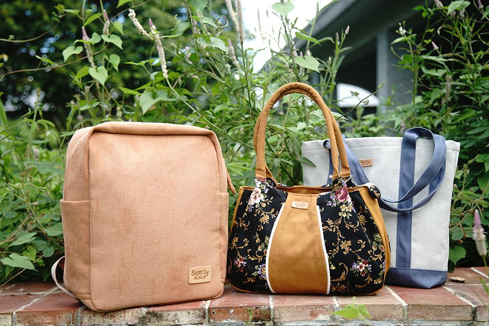 自創品牌杉林布包「sunny bubao」,生產各式包類產品。