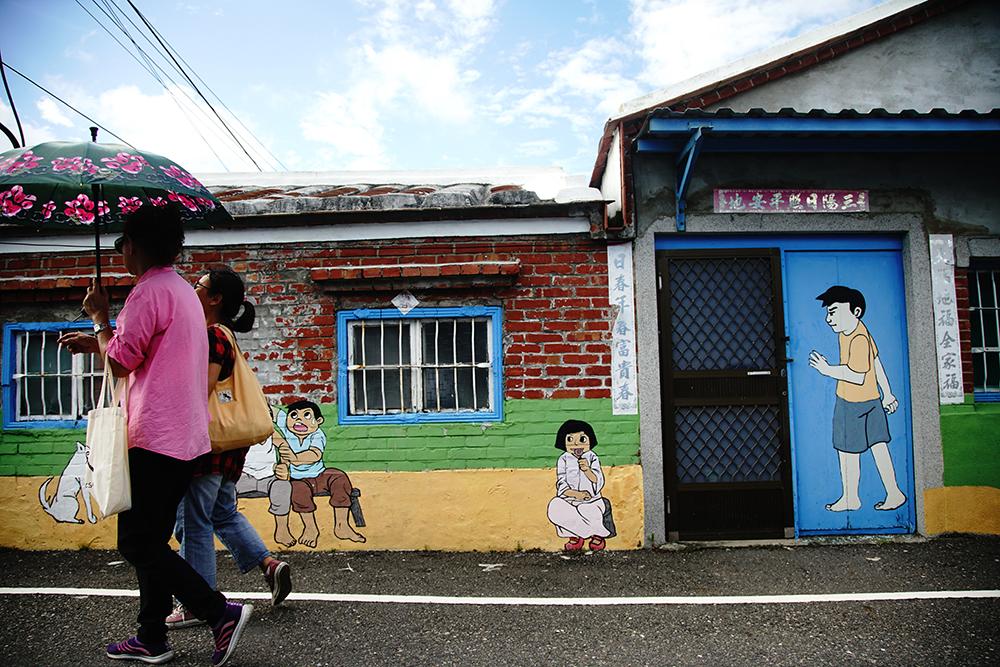 祖厝壁畫是鹽田社區居民的生活日常。